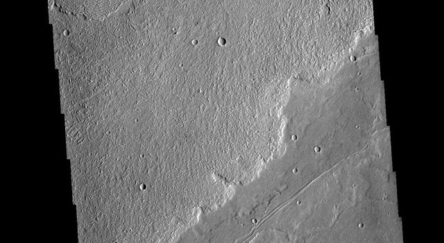 This image from NASAs Mars Odyssey shows a small portion of the immense lava flows that originated from Arsia Mons.