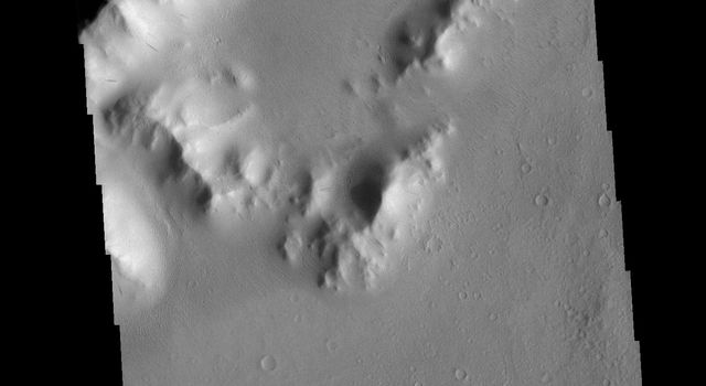 This image from NASAs Mars Odyssey shows part of the central peak and floor of Burton Crater.