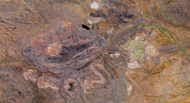 NASAs Terra spacecraft shows the Mount Whaleback open pit iron ore mine, located 6 km west of the town of Newman in the Pilbara region of Western Australia.