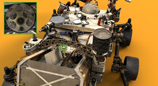 Visible both in the inset photograph on the upper left and near the center of NASAs Perseverance Mars rover in this illustration is the palm-size dome called the Laser Retroreflector Array (LaRA).