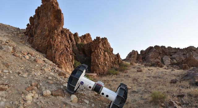 The Tethered Axel Autonomously Descends a Rocky Slope