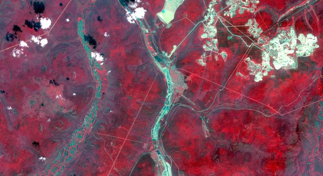 NASAs Terra spacecraft shows Aldan, the administrative center of the Aldansky District in Siberia, Russia. It was founded in 1923 after discovery of rich gold and uranium deposits.
